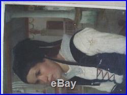 HENRI D'ESTIENNE (1872-1949) Jeune bretonne Huile sur toile, signée et dédicacée